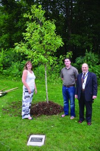 Plymouth Beyond the Yellow Ribbon co-sponsored the addition of this American Dream Oak to be a living part of the Plymouth Veterans Memorial, which was dedicated June 29 at City Hall. Pictured are (from left) PBYR Vice Chair Sylvia Grismer, PBYR Treasurer Allan Crew and PBYR Chair Gary Goldetsky. (Sun Sailor photo by Derek Bartos)