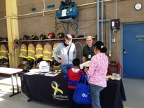 PBYR - Vance Harris, Gary Goldetsky and a Plymouth family at the PBYR booth at the Fire Department's open house on Oct 10, 2015