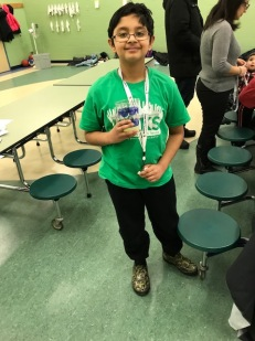 """Si"" , a 5th grader served as our assistant and he did a super job at the event!!"